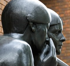 Two statues exchanging rumors
